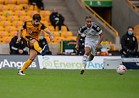 Wolverhampton Wanderers' Ruben Neves (left) crosses the despite the attentions of Fulham's Bobby Reid (right)<br /> <br /> Photographer David Horton/CameraSport<br /> <br /> The Premier League - Wolverhampton Wanderers v Fulham - Sunday 4th October 2020 - Molineux Stadium - Wolverhampton<br /> <br /> World Copyright © 2020 CameraSport. All rights reserved. 43 Linden Ave. Countesthorpe. Leicester. England. LE8 5PG - Tel: +44 (0) 116 277 4147 - admin@camerasport.com - www.camerasport.com