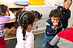 Education preschool 2-3 year olds pretend play group of children pretending to be elephants