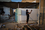 Remi OCHLIK/Neus photo - On august, 23, 2011 In Tripoli - Last assault against Gaddafi compound. Rebels fighters from jebel Nefoussa and Misurata entered in Gaddafi headquarters in the middle afternoon after street fighting and they started looting ammunitions and weapons