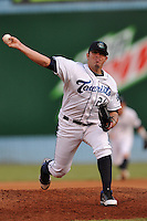 Asheville Tourists pitcher Juan Gonzalez #24 delivers a pitch during game against the Kannapolis Intimidators at McCormick Field on July 20, 2011 in Asheville, North Carolina. Asheville won the game 5-4.   (Tony Farlow/Four Seam Images)