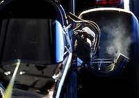 Jan 25, 2009; Chandler, AZ, USA; Smoke comes out of the exhaust pipe on the car driven by NHRA top fuel dragster driver Larry Dixon after warming up the engine during testing at the National Time Trials at Firebird International Raceway. Mandatory Credit: Mark J. Rebilas-