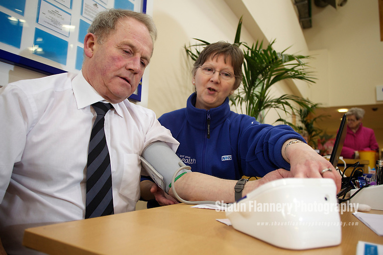 Pix: Shaun Flannery/shaunflanneryphotography.com...COPYRIGHT PICTURE>>SHAUN FLANNERY>01302-570814>>07778315553>>..11th March 2011............Lakeside Village, White Rose Way, Doncaster..Test Your Health - NHS Doncaster Health check..Nurse Marlyn Stothard pictured with customer Peter Bradley.