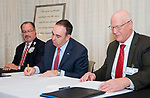 TORRINGTON, CT-121817JS05---Jeffrey Flaks, President and COO of Hartford Healthcare, center, along with Daniel J. McIntyre, President & Executive Director of Charlotte Hungerford Hospital, right, sign documents that officially turnover Charlotte Hungerford Hospital to Hartford Healthcare Thursday in the Memorial Conference Hall at the hospital in Torrington as David Whitehead, Executive Vice President<br /> Chief Strategy and Transformation Officer<br /> Hartford HealthCare, left, looks on. Jim Shannon Republican-American