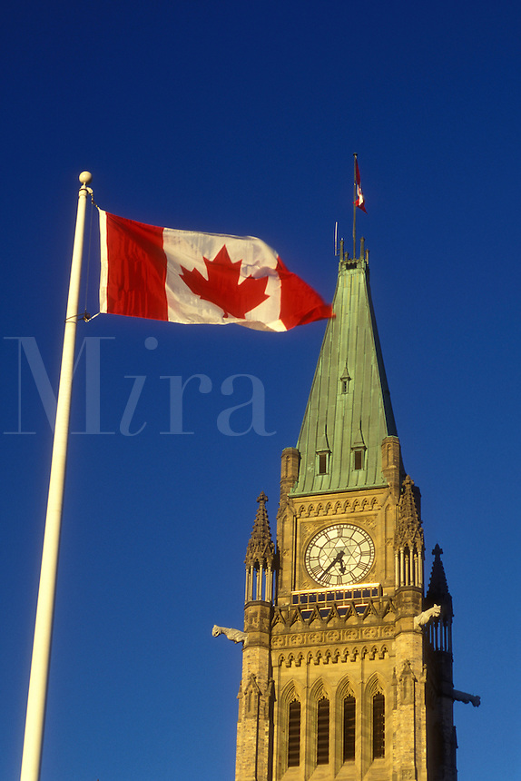 AJ0849, Canada, Ontario, Ottawa, A Canadian flag flies next to the Peace Tower of the Parliament Buildings on Parliament Hill in Ottawa.