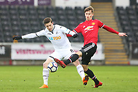 Sunday 18 March 2018<br /> Pictured:  Adnan Maric of Swansea City is challenged by Callum Gribbin of Manchester United<br /> Re: Swansea City v Manchester United U23s in the Premier League 2 at The Liberty Stadium on March 18, 2018 in Swansea, Wales.