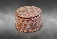 Minoan cylindrical pyxis with lid (jewel box) with incised decoration, Knossos 1900-1800 BC; Heraklion Archaeological  Museum, grey background.