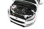 Car Stock 2015 Ford Focus SE Sedan 4 Door Sedan Engine high angle detail view