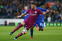 Kyle Walker of Manchester City is challenged by Junior Hoilett of Cardiff City during the Fly Emirates FA Cup Fourth Round match between Cardiff City and Manchester City at the Cardiff City Stadium, Wales, UK. Sunday 28 January 2018