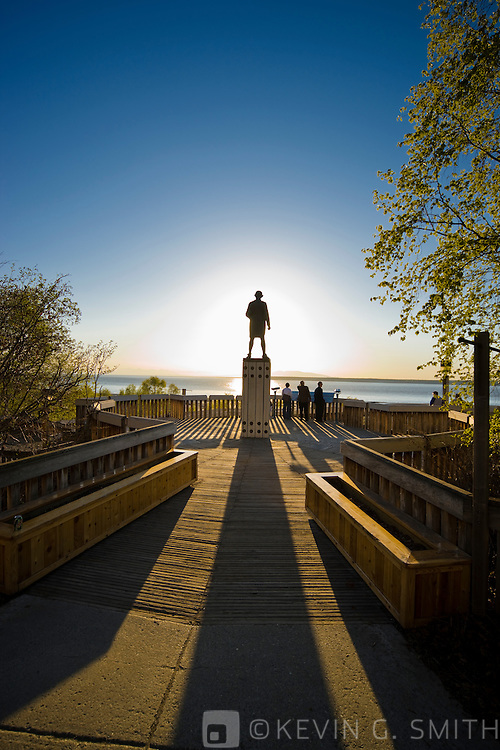 The captain cook monument overlooking Knik Arm in downtown Anchorage, sunset, Spring, Southcentral Alaska, USA.