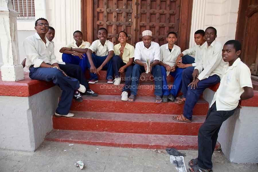 Stone Town, Zanzibar, Tanzania.  Secondary School Boys on a Break.  Arab, African, and Indian Ethnic Groups.