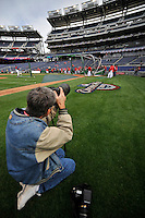 29 March 2008: Washington Nationals team photographer Michell Layton takes photos during batting practice prior to an exhibition game against the Baltimore Orioles at Nationals Park, in Washington, DC. The matchup was the first professional game played in the new ballpark, prior to the upcoming official opening day inaugural game. ..Mandatory Photo Credit: Ed Wolfstein Photo