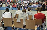 European Championships Fencing 2010 / Fecht Europameisterschaft 2010 in Leipzig - Competition Championat d'europe - in picture: The German mens foil team loses the match against Great Britian (45:41) - Peter Joppich during the last battle (against Laurence Halsted) in background - foreground: the other members of the German team quiet on their chairs  . Foto: Norman Rembarz..Norman Rembarz , Autorennummer 41043728 , Augustenstr. 2, 04317 Leipzig, Tel.: 01794887569, Hypovereinsbank: BLZ: 86020086, KN: 357889472, St.Nr.: 231/261/06432 - Jegliche kommerzielle Nutzung ist honorar- und mehrwertsteuerpflichtig! Persönlichkeitsrechte sind zu wahren. Es wird keine Haftung übernommen bei Verletzung von Rechten Dritter. Autoren-Nennung gem. §13 UrhGes. wird verlangt. Weitergabe an Dritte nur nach  vorheriger Absprache..