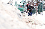 WATERBURY, CT, 08 JANUARY 2011-010811JS01--Eric Espnio, 12, clears snow from the sidewalk in front of his family's Cooke Street home in Waterbury on Saturday. Nearly a foot of snow fell in the Greater Waterbury area on Friday. <br /> Jim Shannon Republican-American