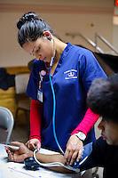 Columbia University Medical Center. Nursing School students with Liz Cohen health project at Abbysinian Church in Harlem.