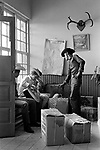 Cowboys 1960s USA Greyhound bus station border Texas and Mexico border crossing into Mexico1969. Mexican American cowboys in a Mexican border town bus station. They are taking the packages on the floor home across the border.
