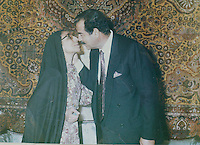 Baghdad, Iraq, Saddam's family pictures, date unknown..Saddam, kissing an unidentified woman (probably the mother from the bride of his his elder son Oudai the day of their wedding).