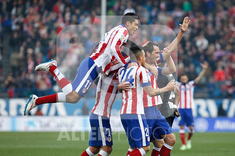 Atletico de Madrid´s Diego Godini celebrates a goal with Gimenez, Griezmann, Raul Jimenez and Gabi during 2014-15 La Liga match at Vicente Calderon stadium in Madrid, Spain. January 03, 2015. (ALTERPHOTOS/Victor Blanco)