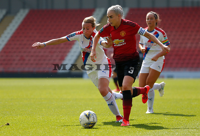 Alex Greenwood of Manchester United Women runs through Palace defence