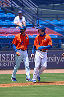 St. Lucie Mets Pete Crow-Armstrong (4) smiles as he rounds third with manager Reid Brignac (15) looking on during a game against the Jupiter Hammerheads on May 5, 2021 at Clover Park in St. Lucie, Florida.  (Mike Janes/Four Seam Images)