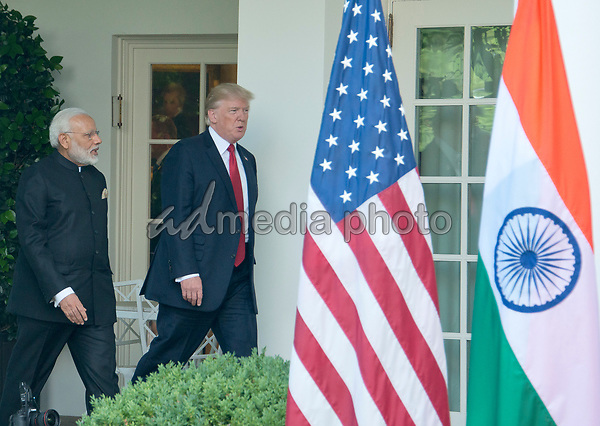 United States President Donald J. Trump and  Prime Minister Narendra Modi of India arrive to deliver joint statements in the Rose Garden of the White House in Washington, DC on Monday, June 26, 2017. Photo Credit: Ron Sachs/CNP/AdMedia