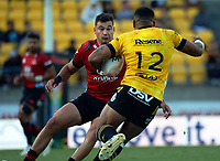 Ngani Laumape runs at David Havili during the Super Rugby Aotearoa match between the Hurricanes and Crusaders at Sky Stadium in Wellington, New Zealand on Sunday, 11 April 2020. Photo: Dave Lintott / lintottphoto.co.nz
