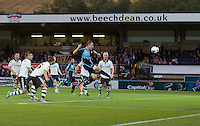 Garry Thompson of Wycombe Wanderers is clear but his shot at goal is off target during the Capital One Cup match between Wycombe Wanderers and Fulham at Adams Park, High Wycombe, England on 11 August 2015. Photo by Andy Rowland.