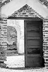 Black and white image of mission doorways emphasizing geometrical shapes