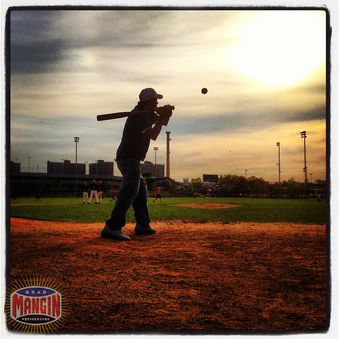 NEW YORK, NY - SEPTEMBER 14:  Instagram of a coach hitting ground balls to his kids at Heritage Field on the site of old Yankee Stadium before the game between the Tampa Bay Rays and New York Yankees at Yankee Stadium on September 14, 2012 in the Bronx borough of New York City. Photo by Brad Mangin