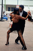 Buenos Aires, Argentina. Couple dancing the Tango outside on the street.