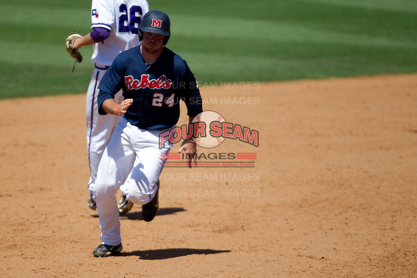Designated Hitter Sikes Orvis #24 of the Ole Miss Rebels rounds second base on his way to third during the NCAA Regional baseball game against the Texas Christian University Horned Frogs on June 1, 2012 at Blue Bell Park in College Station, Texas. Ole Miss defeated TCU 6-2. (Andrew Woolley/Four Seam Images).