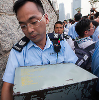 Hong Kong police move tear gas, clearly labelled as coming from the UK on the box, outside the PLA barracks in Hong Kong.   After five days OF mass civil disobedience in Hong Kong the  Occupy Central, aka, The umbrella revolution has reached a stand-off,  Hong Kong, China,02-Oct- 2014