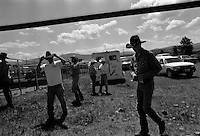 Cowboys wait for the beginning of competition at the annual Lincoln Rodeo in Lincoln, MT in June 2006.  The Lincoln Rodeo is an open rodeo, which means competitors need not be a member of a professional rodeo association.