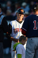 Rochester Red Wings manager Gene Glynn (8) during the lineup exchange before an International League playoff game against the Pawtucket Red Sox on September 5, 2013 at Frontier Field in Rochester, New York.  Pawtucket defeated Rochester 7-2.  (Mike Janes/Four Seam Images)