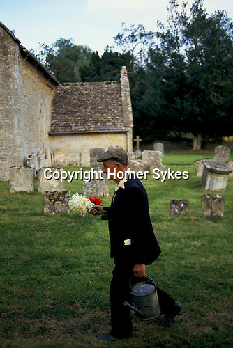 'ENGLISH VILLAGE FETE', ALBERT WEARING WALKING TO THE VILLAGE FETE WITH HIS BEST DAHLIAS.