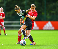 Aster Janssens (5) of Standard  and Justine Blave (22) of Eendracht Aalst battle for the ball during a female soccer game between Standard Femina de Liege and Eendracht Aalst dames on the fourth matchday in the 2021 - 2022 season of the Belgian Scooore Womens Super League , Saturday 11 th of September 2021  in Angleur , Belgium . PHOTO SPORTPIX | BERNARD GILLET