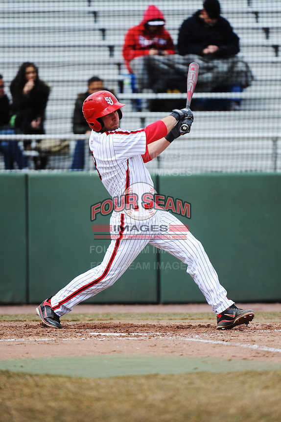 St. John's University Redstorm infielder Bret Dennis (8) during game 1 of a double header against the University of Cincinnati Bearcats at Jack Kaiser Stadium on March 28, 2013 Queens, New York.  St. John's defeated Cincinnati 6-5 in game 1.                                                                 (Tomasso DeRosa/ Four Seam Images)