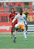 18 July 2009: Houston Dynamo forward Kei Kamara #10 handles a ball in a game between the Toronto FC and Houston Dynamo..The game ended in a 1-1 draw..