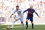 Sergio Ramos (L) of Real Madrid fights for the ball with Andres Iniesta Lujan of FC Barcelona during the La Liga 2017-18 match between Real Madrid and FC Barcelona at Santiago Bernabeu Stadium on December 23 2017 in Madrid, Spain. Photo by Diego Gonzalez / Power Sport Images