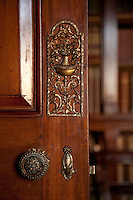 Detail of the metal doorplate on the door to the library