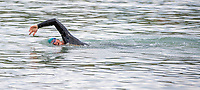 BNPS.co.uk (01202) 558833. <br /> Pic: CorinMesser/BNPS<br /> <br /> WITH VIDEO.... https://we.tl/t-SFb73n4lYU<br /> <br /> Pictured: Oly in training to swim around the Isle of Wight <br /> <br /> A super-fit eco-campaigner has smashed the world record for the fastest person to swim around the Isle of Wight.<br /> <br /> Oly Rush completed the gruelling 65 mile swim in 15 hours 9 minutes, beating the previous best by an astonishing 11 hours.<br /> <br /> The 36-year-old set off at 11am on Monday from Seaview, near Ryde, and swam non-stop anti-clockwise around the isle before finishing at 2.09am Tuesday.