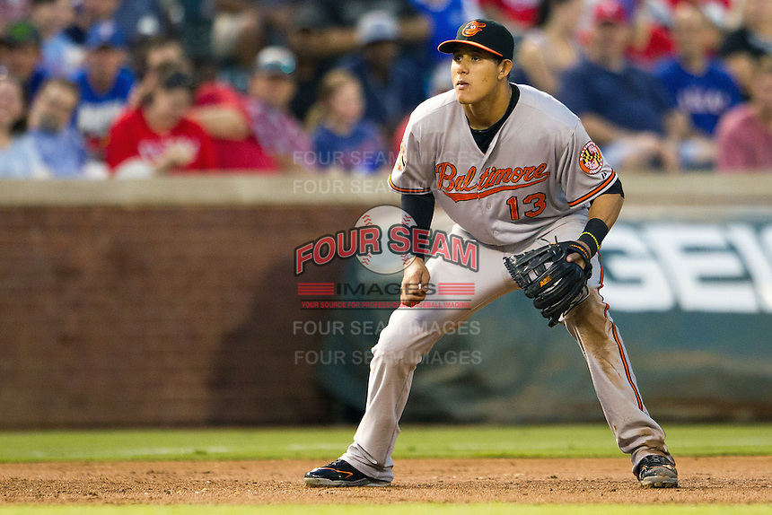Baltimore Orioles third baseman Manny Machado #13 on defense during the Major League Baseball game against the Texas Rangers on August 21st, 2012 at the Rangers Ballpark in Arlington, Texas. The Orioles defeated the Rangers 5-3. (Andrew Woolley/Four Seam Images).