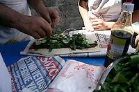 Street vendor preparing cig kofte by the Mardin gate, Diyarbakir, southeastern Turkey
