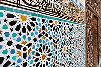 Fes, Morocco.  Attarine Medersa, 14th. Century.  Geometric Tile Design under Arabic Calligraphy.