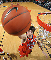 Feb. 2, 2011; Charlottesville, VA, USA; Clemson Tigers center Catalin Baciu (10) grabs a rebound during the game against the Virginia Cavaliers at the John Paul Jones Arena. Mandatory Credit: Andrew Shurtleff
