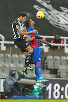 2nd February 2021; St James Park, Newcastle, Tyne and Wear, England; English Premier League Football, Newcastle United versus Crystal Palace; Isaac Hayden of Newcastle United and Jordan Ayew of Crystal Palace compete for the header