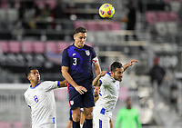 FORT LAUDERDALE, FL - DECEMBER 09: Aaron Long #3 of the United States clears the box with a head ball during a game between El Salvador and USMNT at Inter Miami CF Stadium on December 09, 2020 in Fort Lauderdale, Florida.