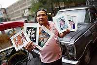 A man sells pictures of famous Luchadores (fighters) outside the Arena Mexico before a Lucha Libre match. Lucha Libre is a style of wrestling started in Mexico in 1933. The name means Free Fight, and matches tend to be focussed on spectacle and theatre with fans cheering for their favourite characters, who wear masks while jumping from the ropes, flipping opponents, and occasionally crashing into the crowd..©Jacob Silberberg/Panos/Felix Features.