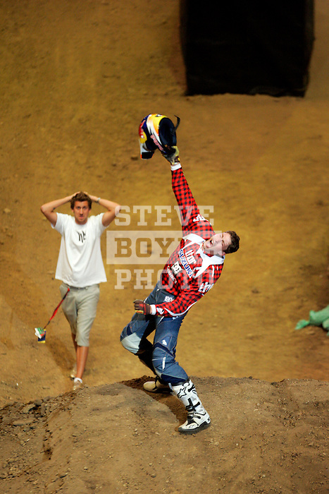 Travis Pastrana celebrates his double backflip after competing in the Moto X Best Trick competition during X-Games 12 in Los Angeles, California on August 4, 2006.