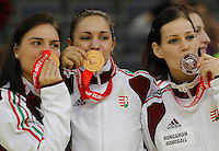 BELGRADE, SERBIA - DECEMBER 16: Hungary players Anita Gorbicz (R) Orsolya Verten (L) and Zita Szucsanszki (C) posing with medals during the Women's European Handball Championship 2012 medal ceremony at Arena Hall on December 16, 2012 in Belgrade, Serbia. (Photo by Srdjan Stevanovic/Getty Images)