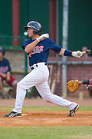 Gunner Glad #11 of the Elizabethton Twins follows through on his swing against the Kingsport Mets at Joe O'Brien Field August 14, 2010, in Elizabethton, Tennessee.  Photo by Brian Westerholt / Four Seam Images